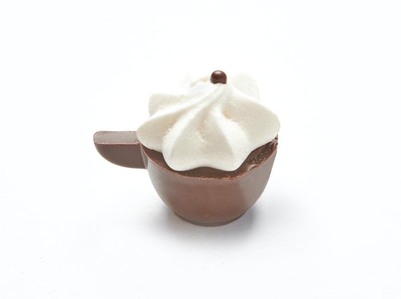 TRES LECHES Tres Leches in creamy milk chocolate topped with a meringue. Dark shell. Gluten-free
