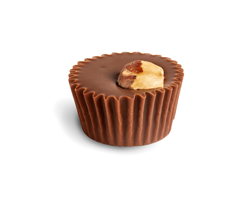 HAZELNUT MILK CUP Solid dark milk chocolate, Oregon roasted Hazelnuts for a classic combination. Gluten-free