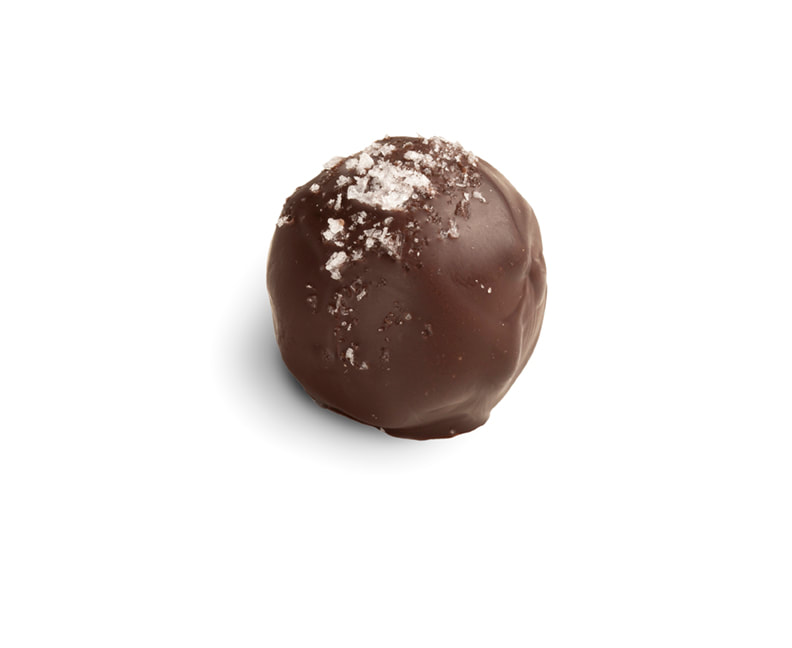 SALTED CARAMEL Soft creamy caramel with a trace of rum, topped with sea salt for a burst of flavors. Dark shell. Gluten-free.